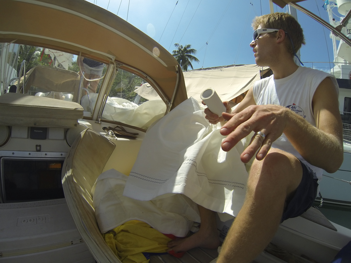 Hand-stitched sail repair to the solent jib, St. Lucia