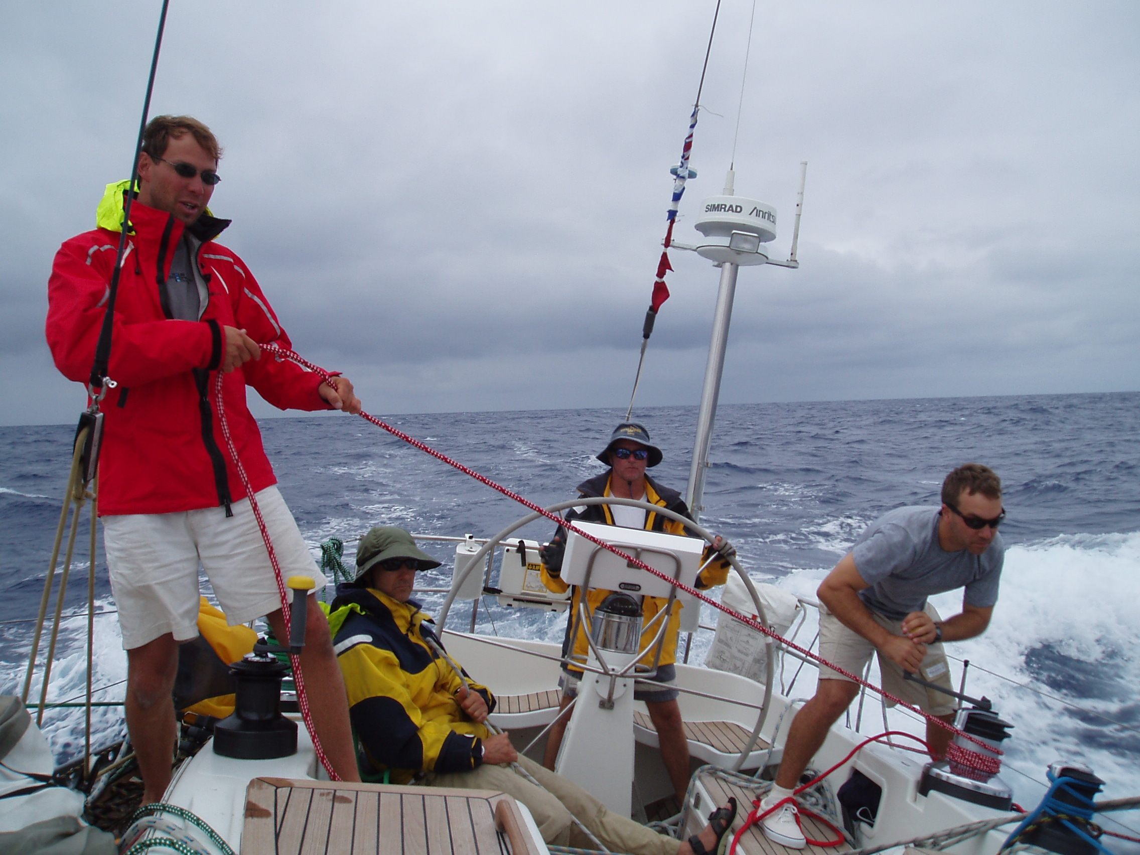That's Paul trimming the chute en route to Hawaii on another S&S Swan 48.