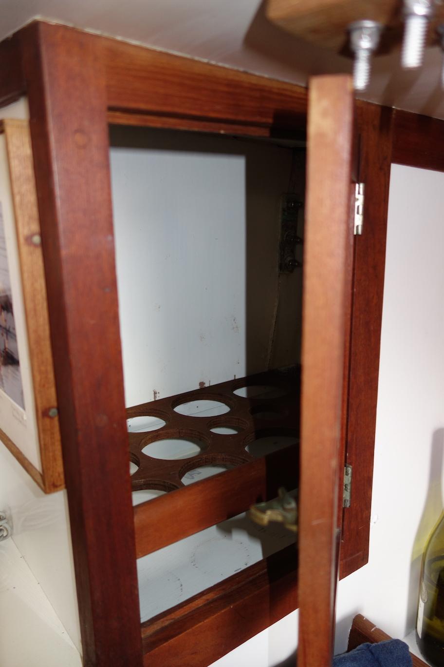 Wine locker! Forward of the starboard settee.