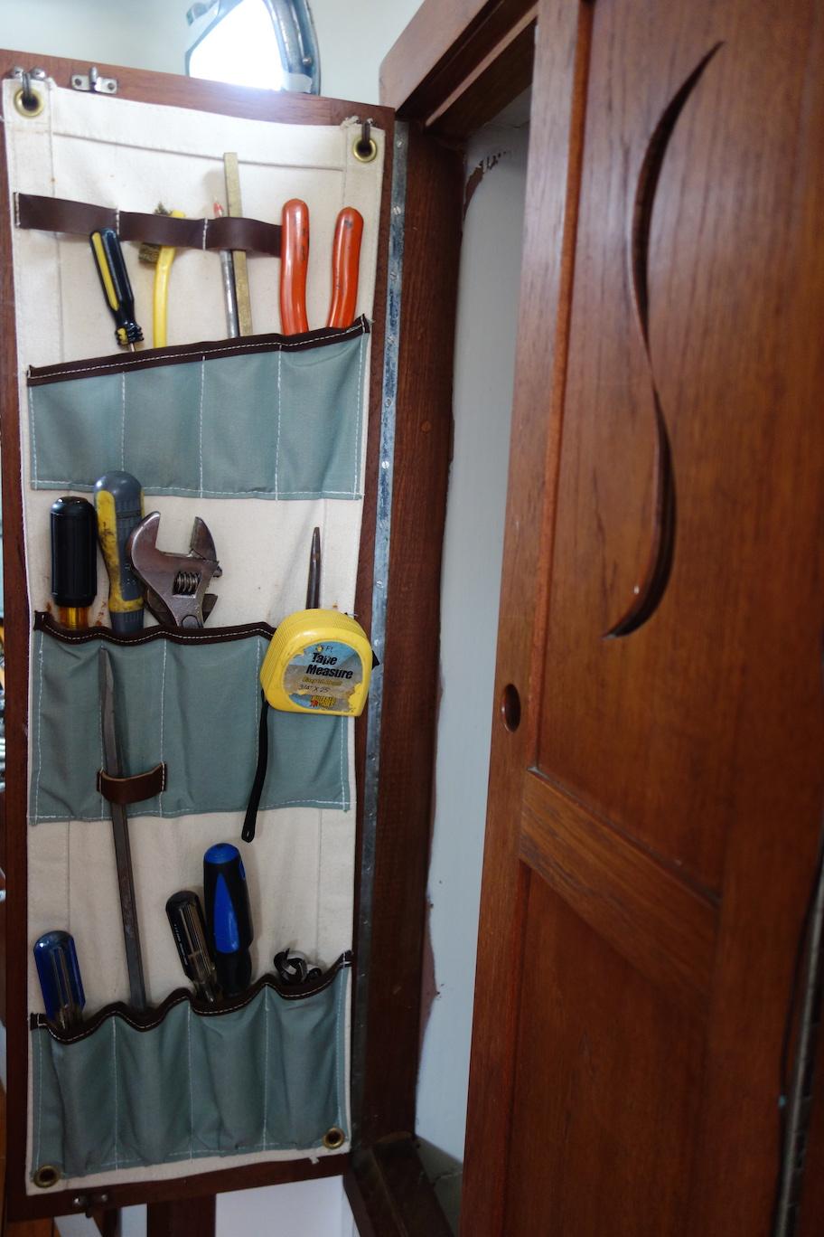 Custom canvas tool storage inside hanging locker.