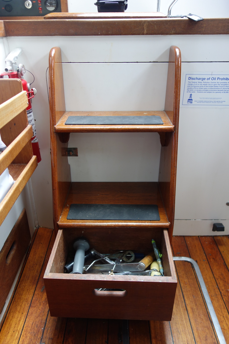 Clever drawer under the steps for winch handles and such.