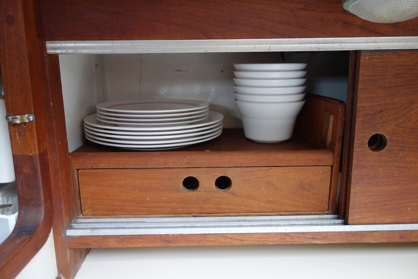 Clever galley storage for plates and cutlery.