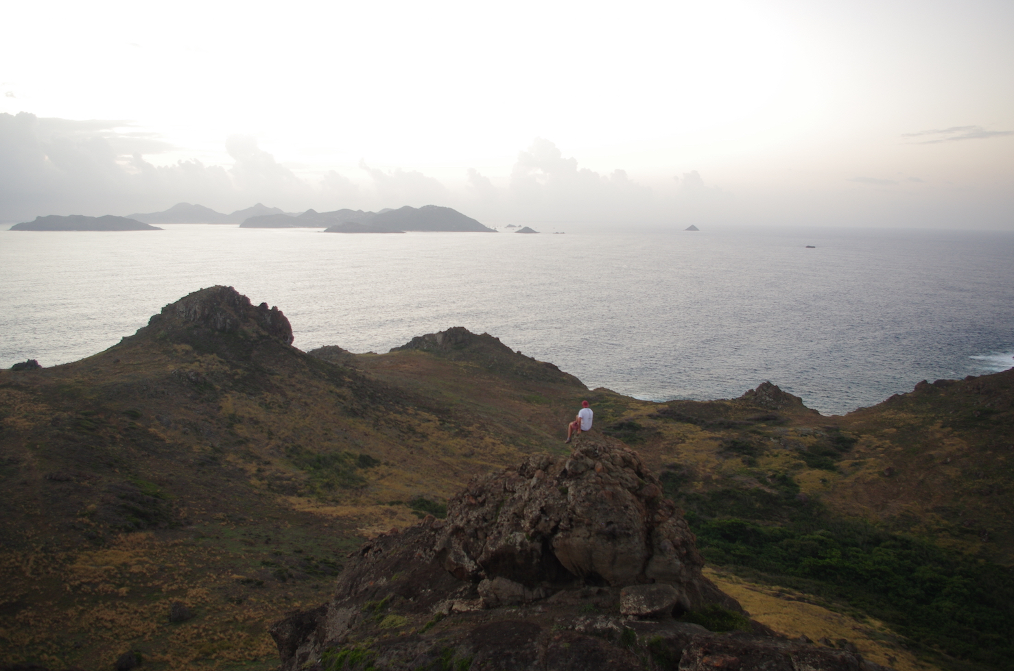 Ryan atop an adjacent peak, St. Barth's in the background.