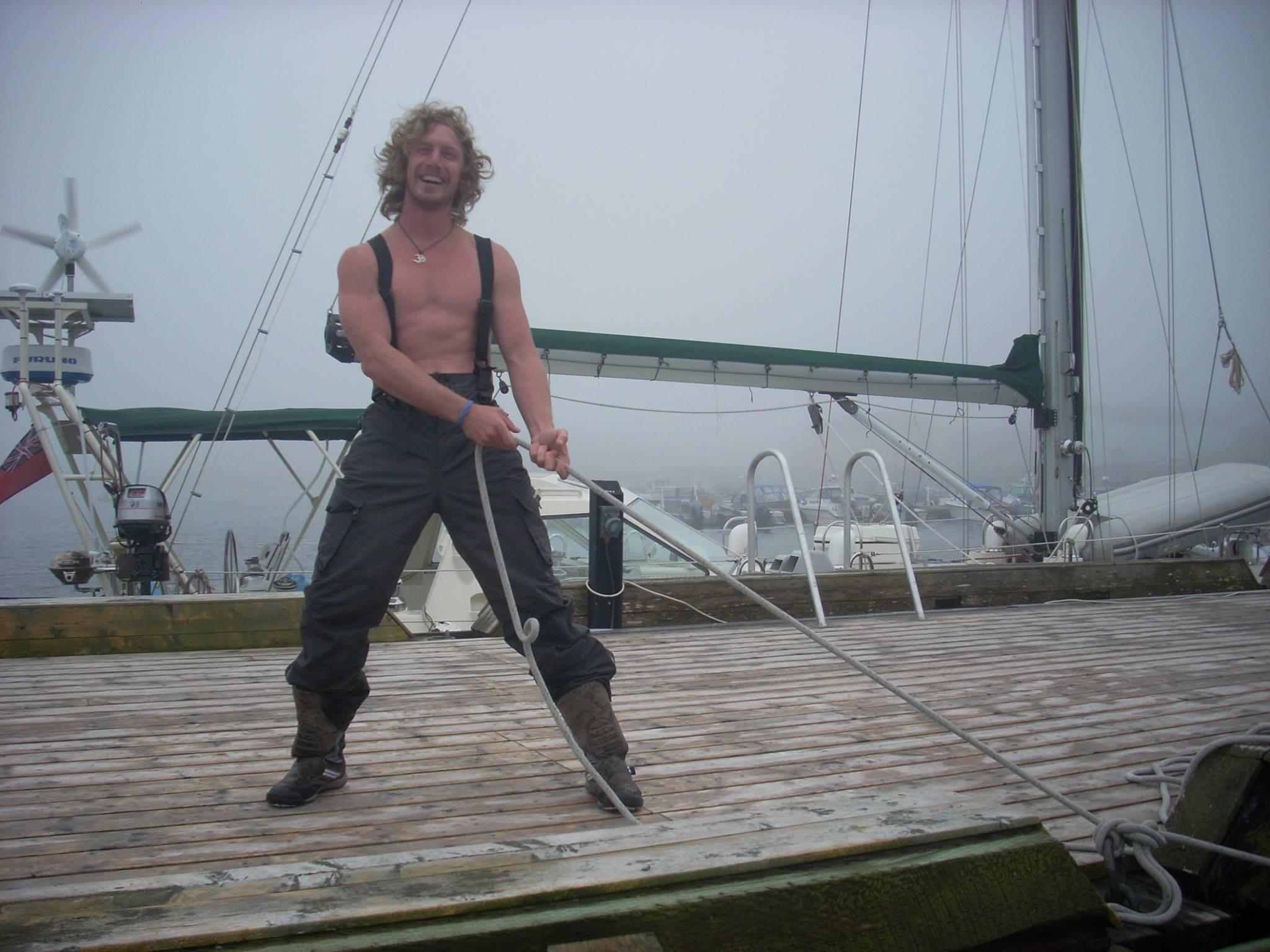 Clint helping tie the docklines on Arcturus in St. Pierre in 2011, en route across the Atlantic.