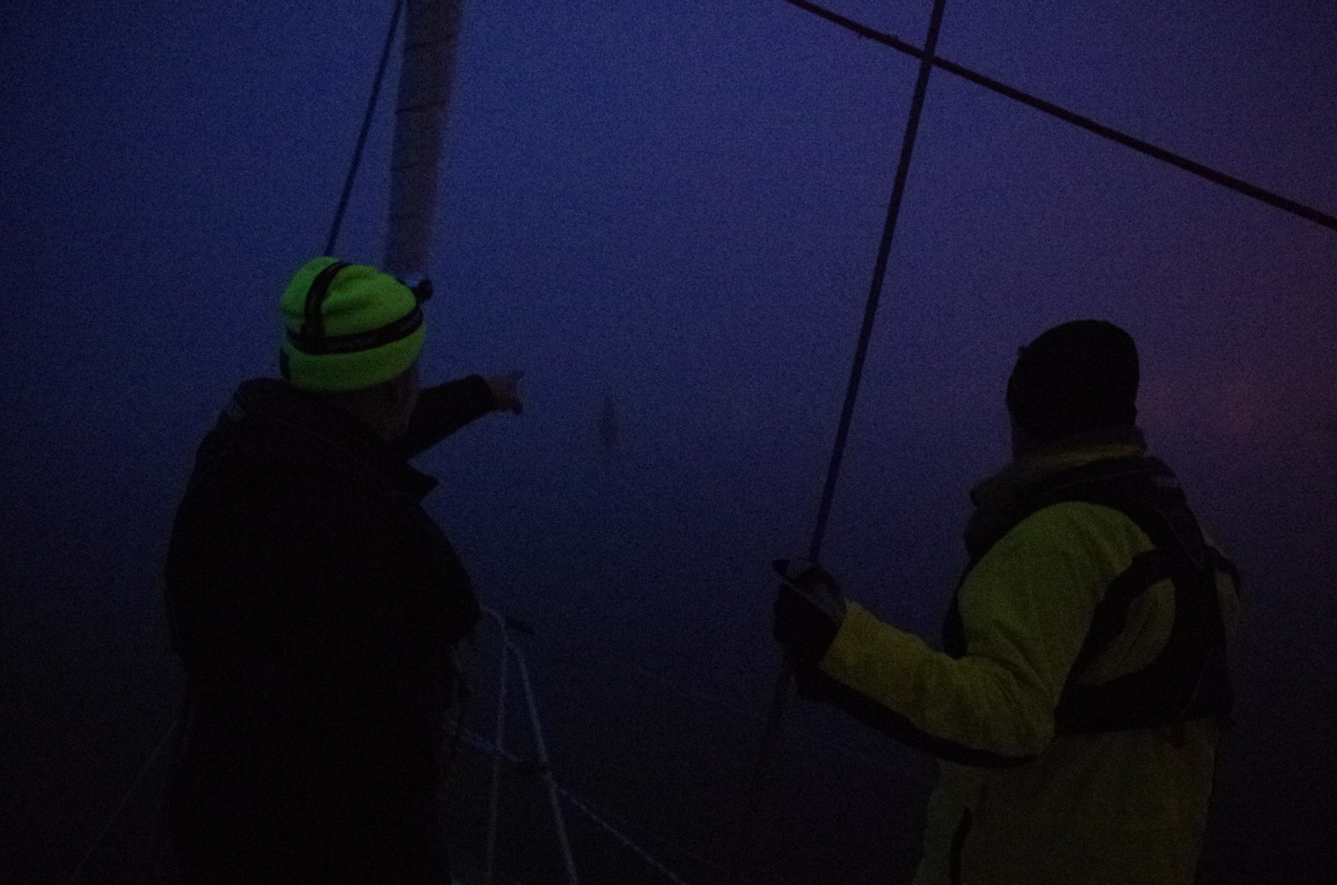 Dan (left) and Doug (right), spotting on the bow as we entered St. Pierre in the fog.