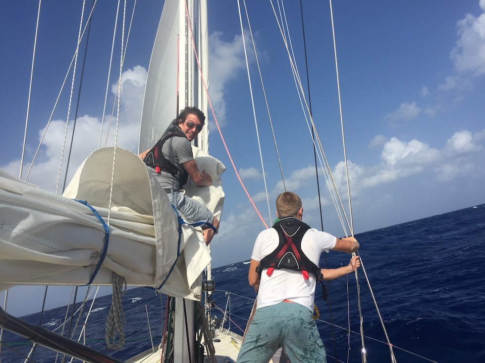 Clint Wells & Andy rigging the trysail after blowing out the mainsail.