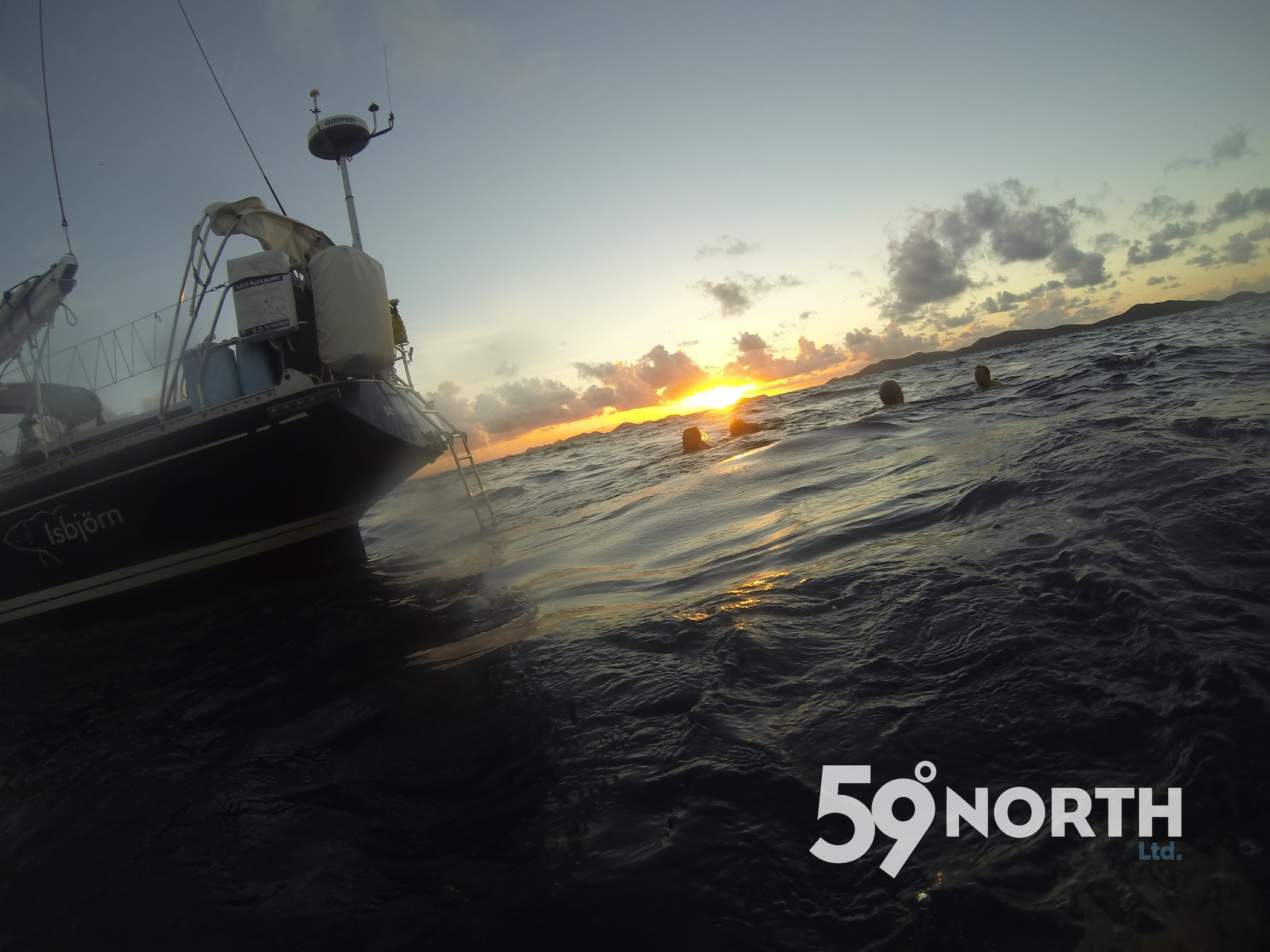 Swimming during moonset and sunrise after we crossed the finish line and before entering the marina!