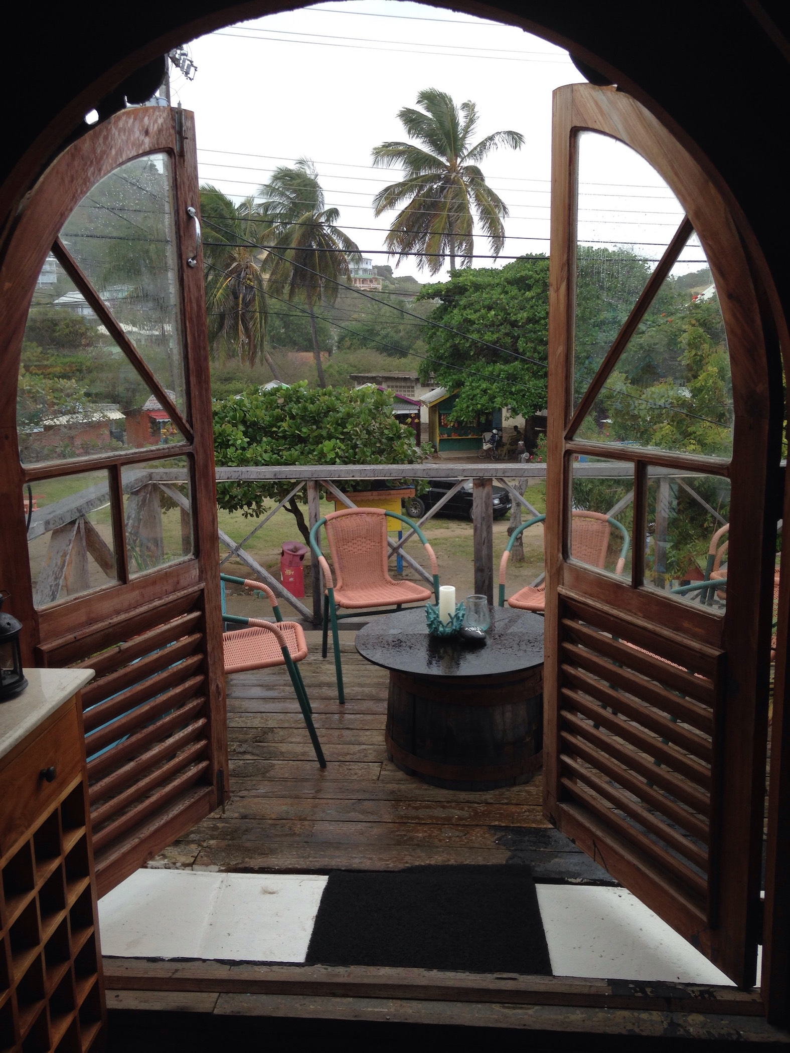 The Loft, Union Island! Sweet balcony overlooking the street and the market before the squall hit.