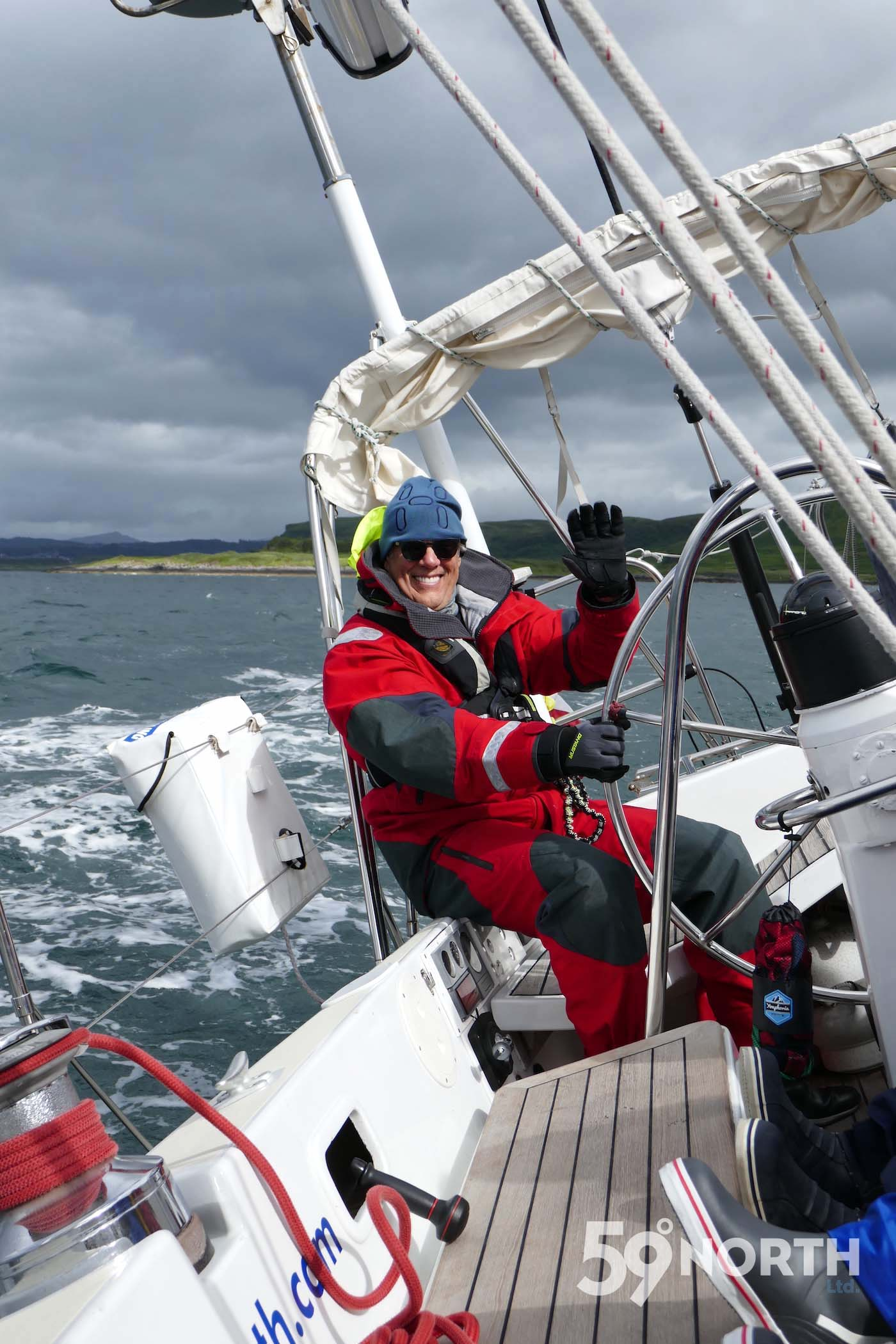 Karl at the helm sailing out of Oban. Leg 8, 2017: Sweden to Scotland 59-north.com