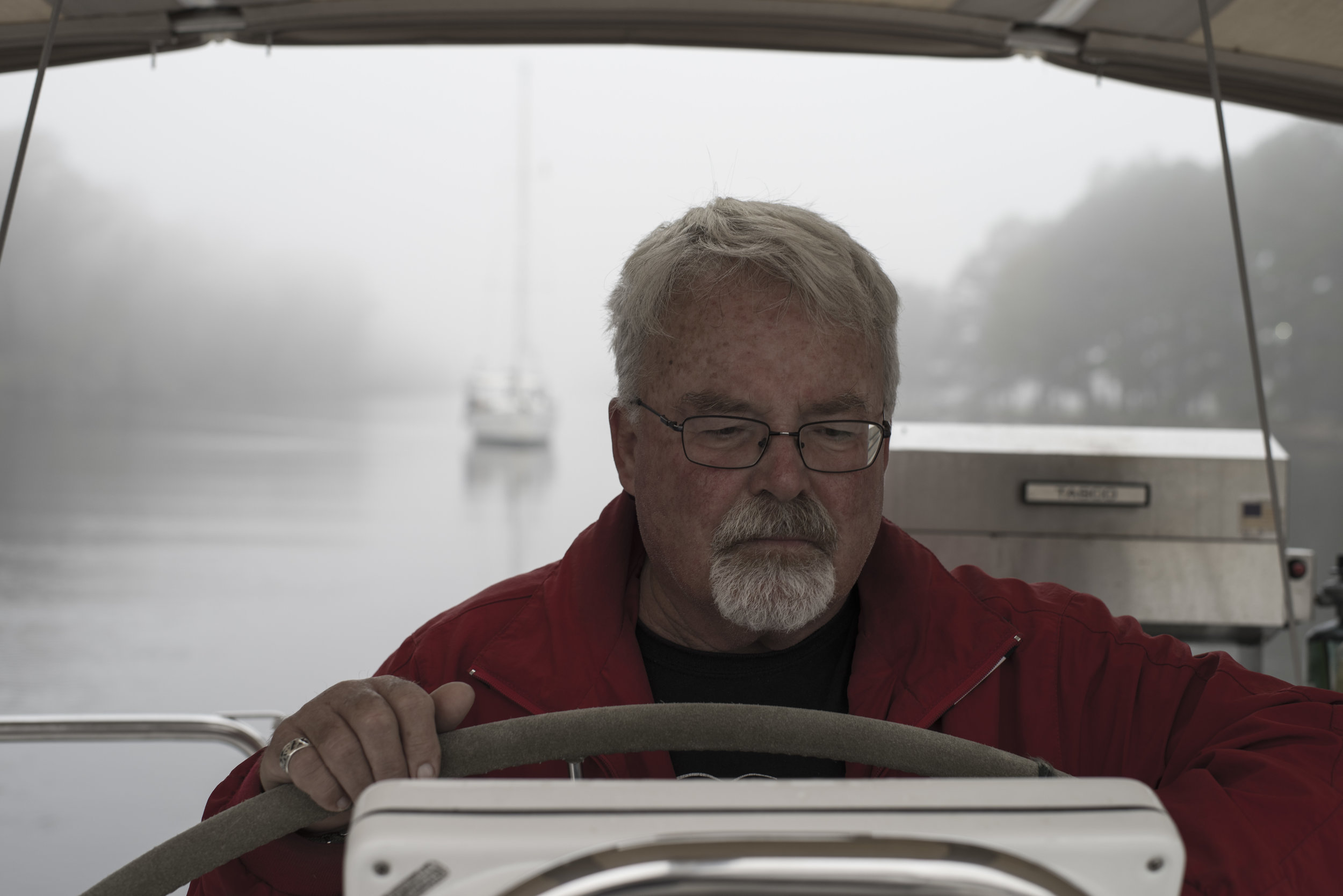 Capt. Dennis (aka 'Andy's Dad') at the helm in the morning mist a few days back.