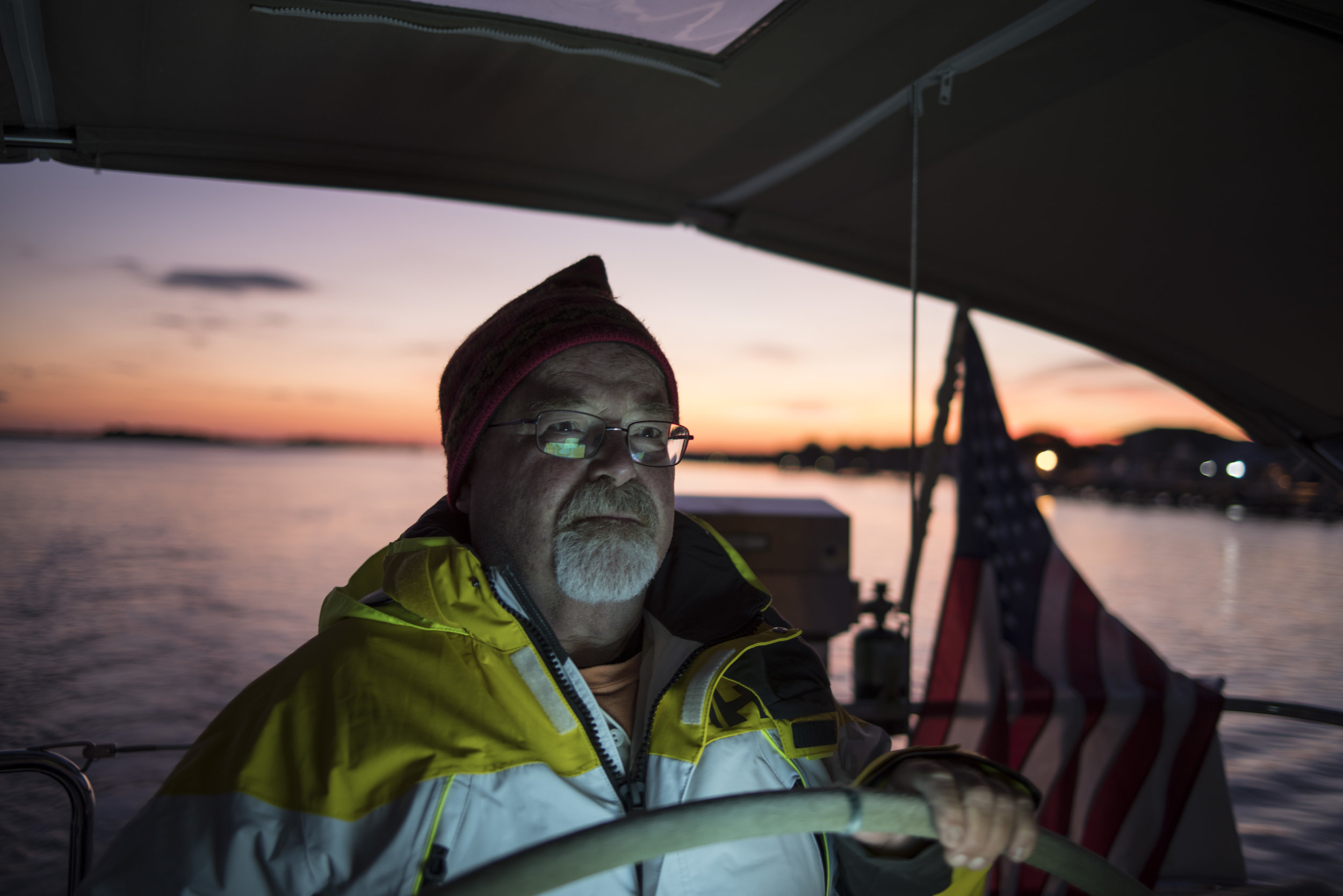 Captain Dennis at the helm at dusk as we anchored.