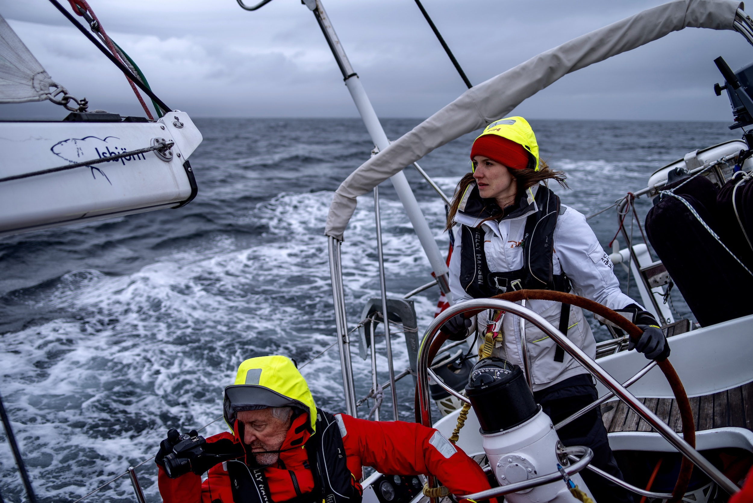 Laura at the helm while Tom films Isbjorn charging upwind in the Vestfjord.