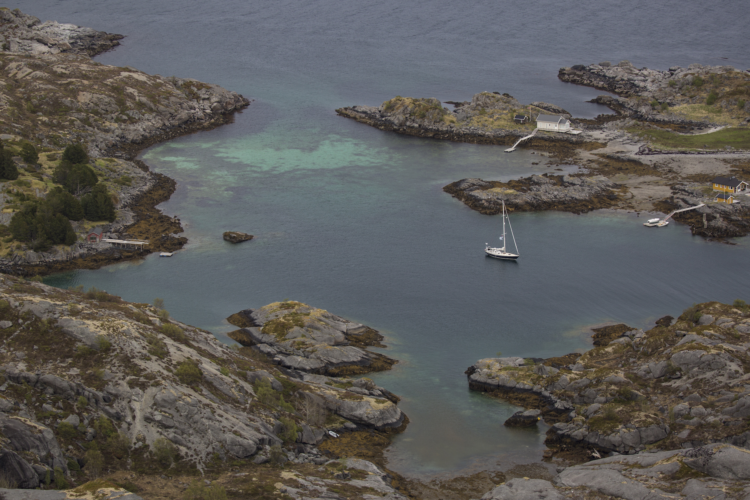 Isbjorn's anchorage in Straumøya. That little cove to the bottom was FILLED with mussles! Can you spot our dinghy?!