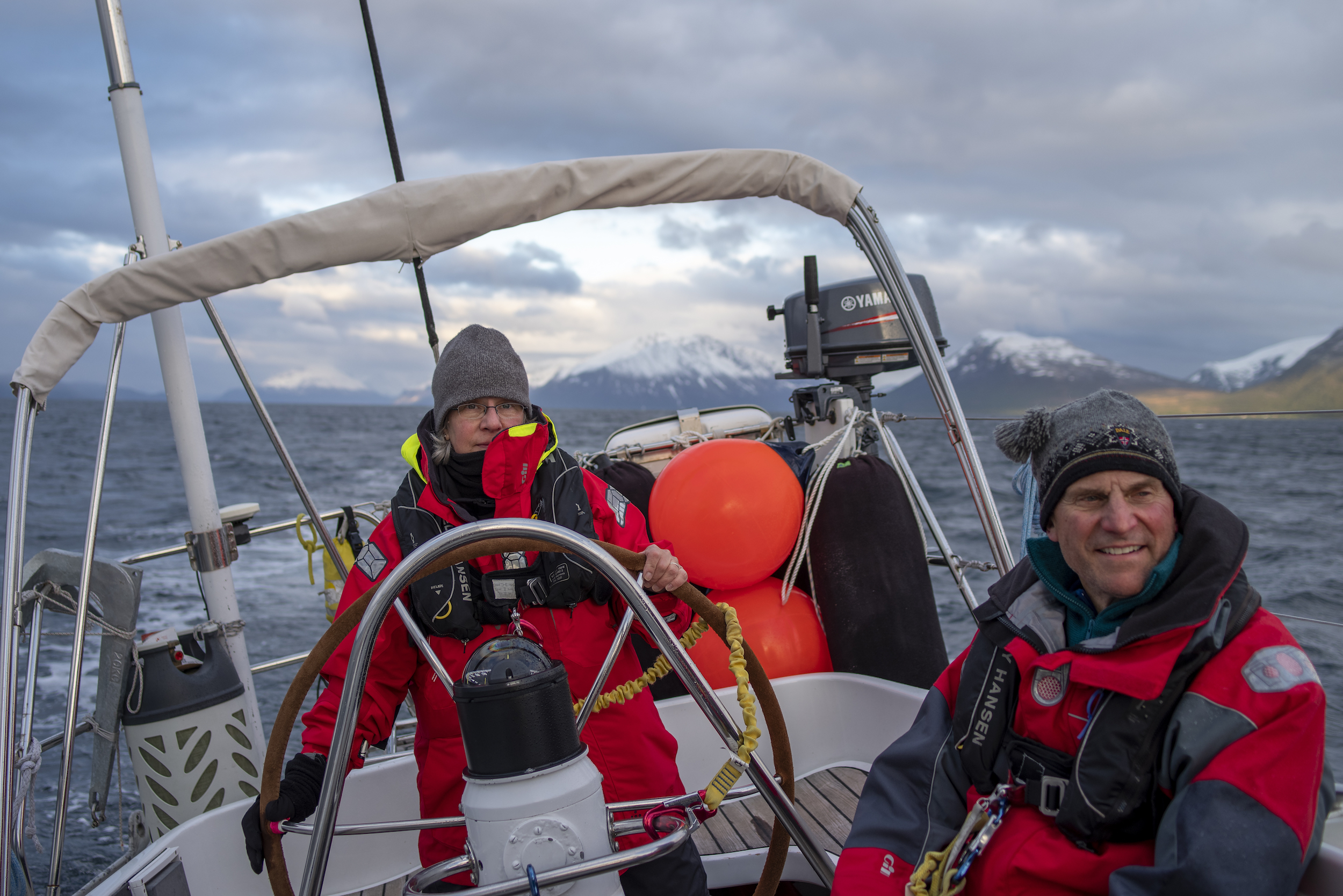 Patty & her husband Dave pilot Isbjorn in the midnight sun through the last of Norway's mainland fjords on the way offshore & NORTH. Dave sailed with us in 2016 to St. John's Newfoundland.