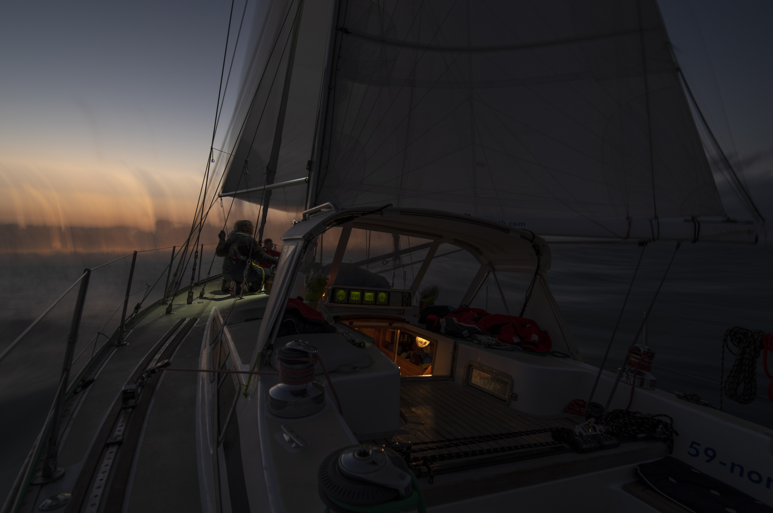 Sunset spinnaker takedown.