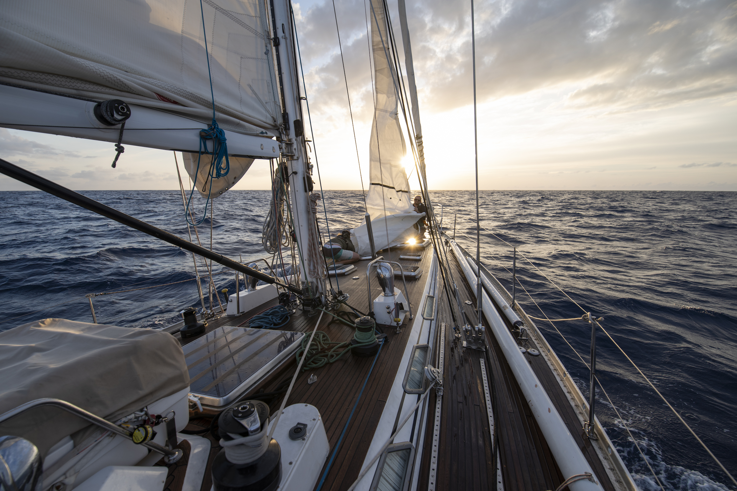 Bob, Ryan & Colin wrestle the staysail down at sunset en route to Bermuda.