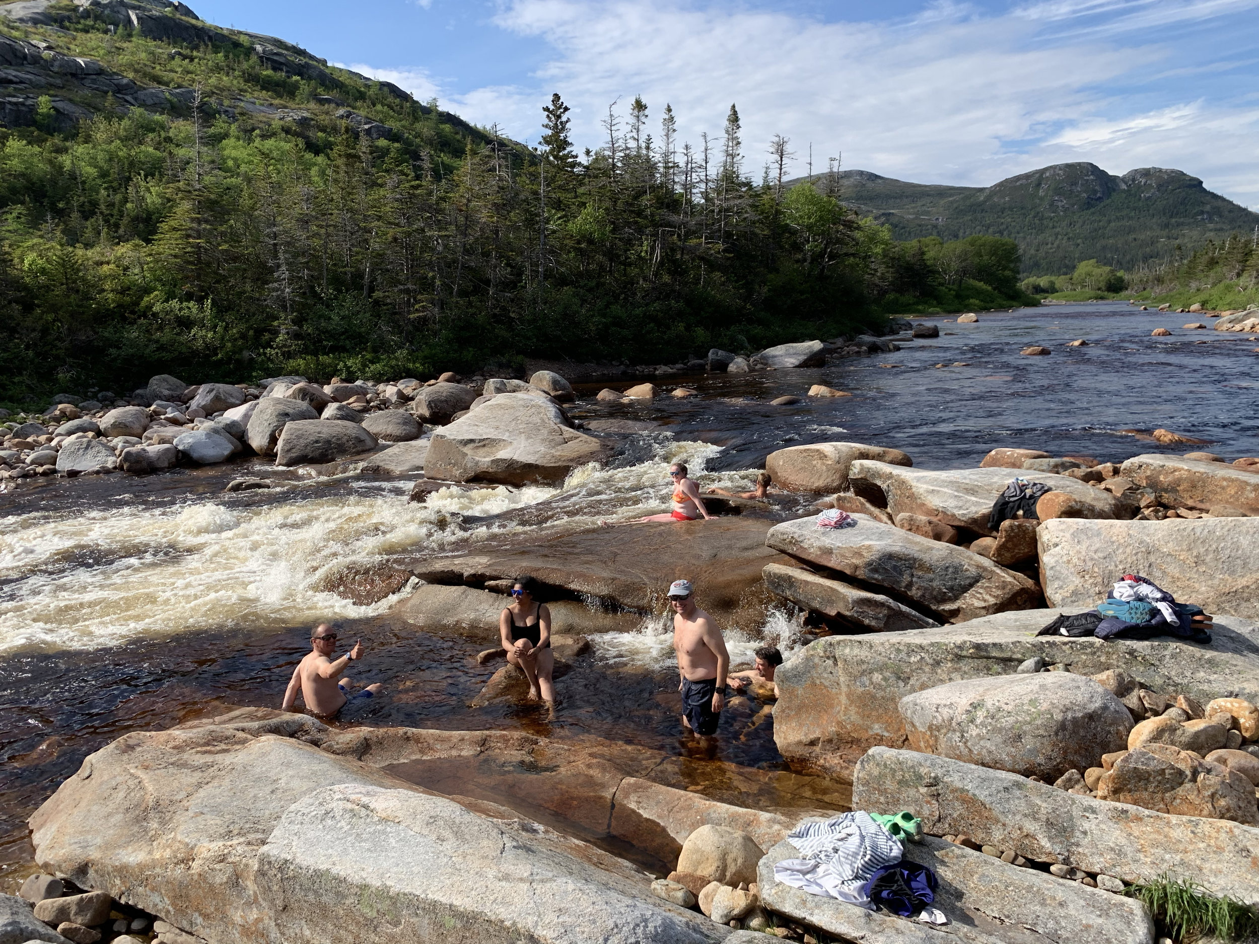 Freshwater swim in the Morgan River, above Morgan Falls in the NE Arm of Hare Bay fjord.