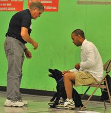 "Harold Hansen helping a student at his ""Heeling Free"" Dog School in Eugene"
