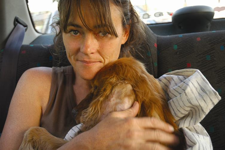 Vanessa with Bob, an owned Cocker Spaniel so sick he could not stand, rescued while filming. (Photo by Chris Mortimer)