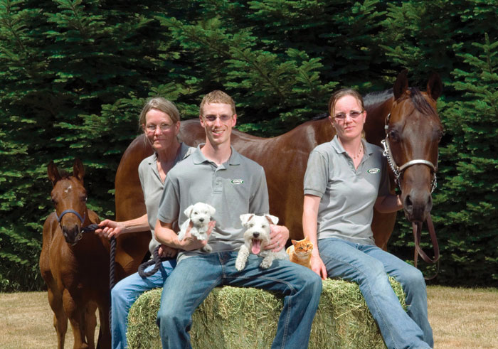 Pictured (l to r) Sue Smith, Ben and Elana Hoerter. Horses, Bella and Christy, dogs Amy and Hannah and Sammy the cat.