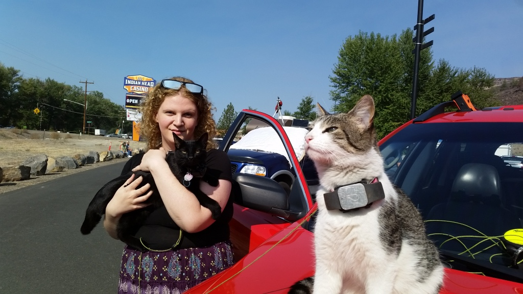 Pixie and Mr. Jinx (Haylee holding him) at the Casino in Warm Springs during the eclipse.