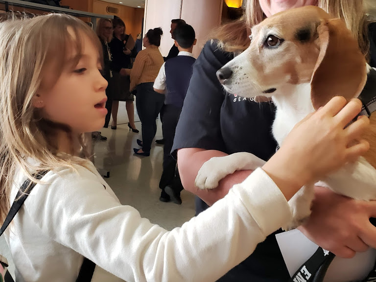 Elle, a 2nd grade student from Portland, greets Layla in the lobby after testifying in favor of SB 638-A.