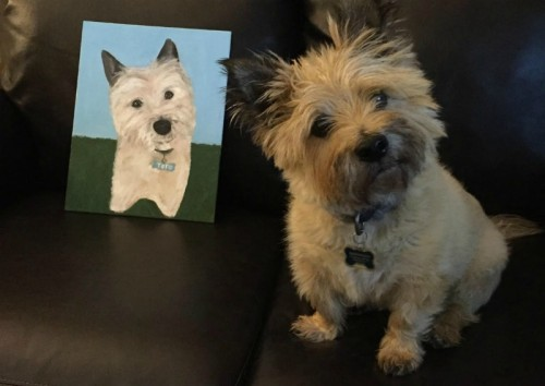 The author's artwork, next to a satisfied customer.