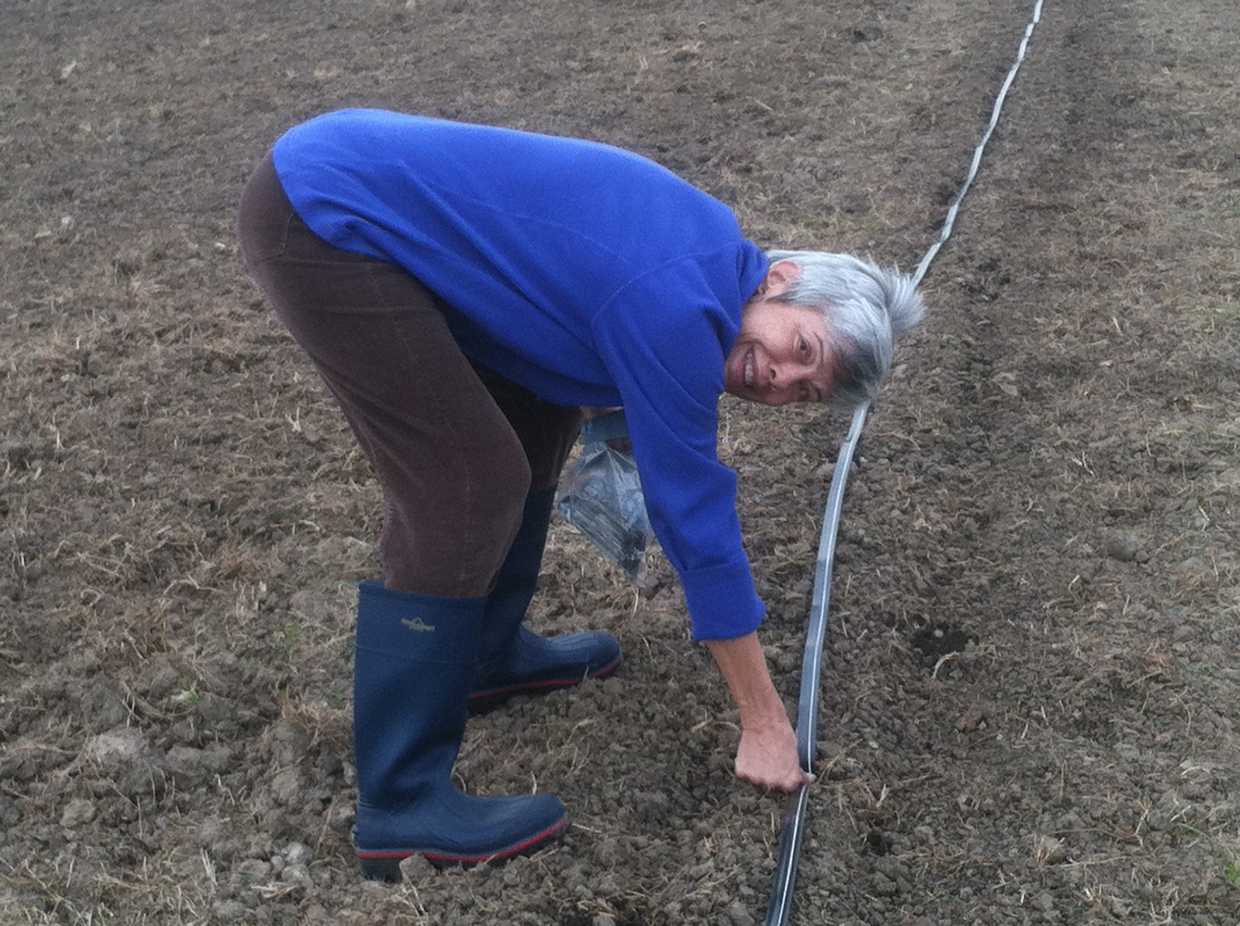 My little ma, pinning down the tape to keep it in place.