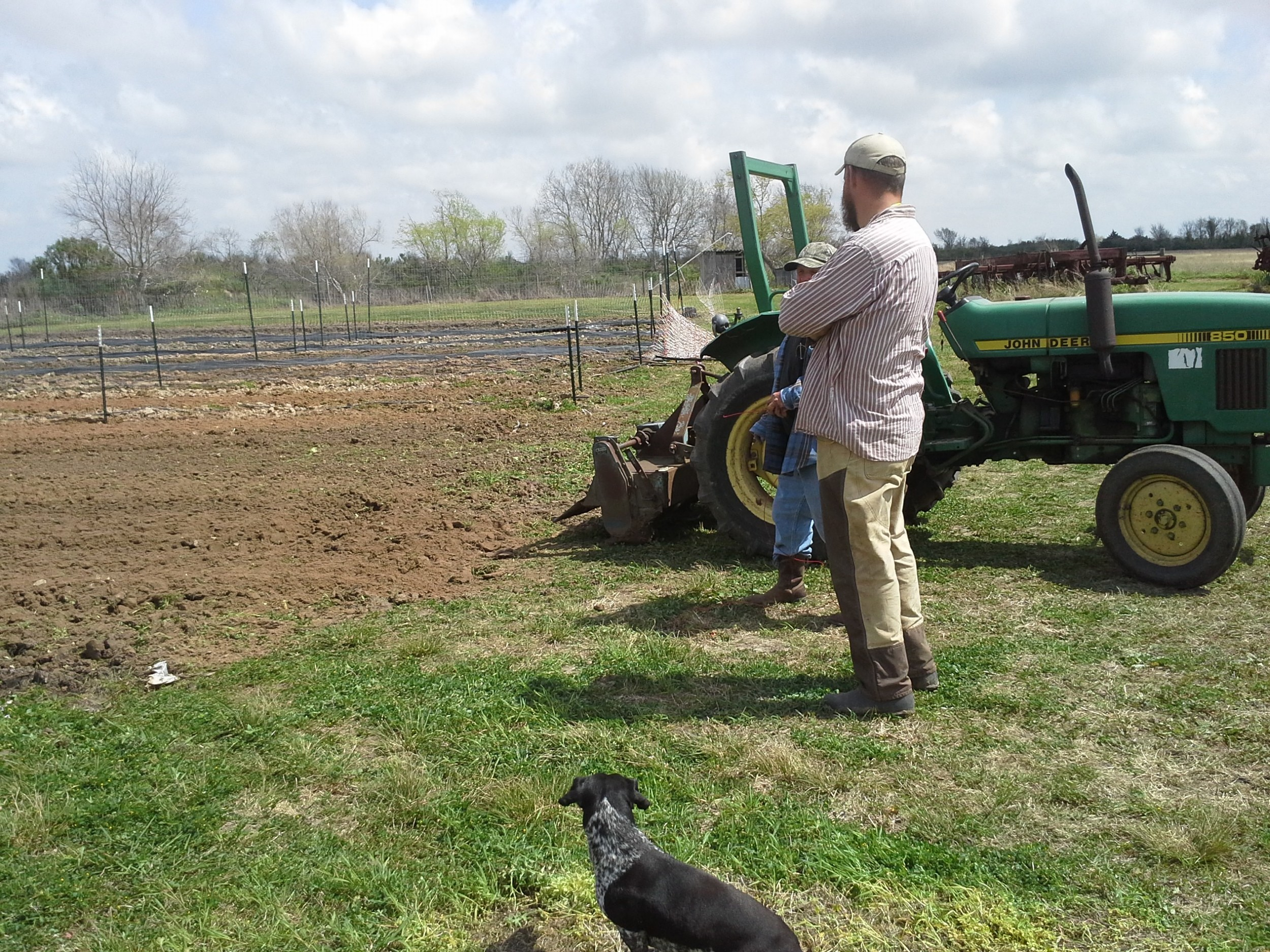 McFarmer mulls tilling options with our neighbor.