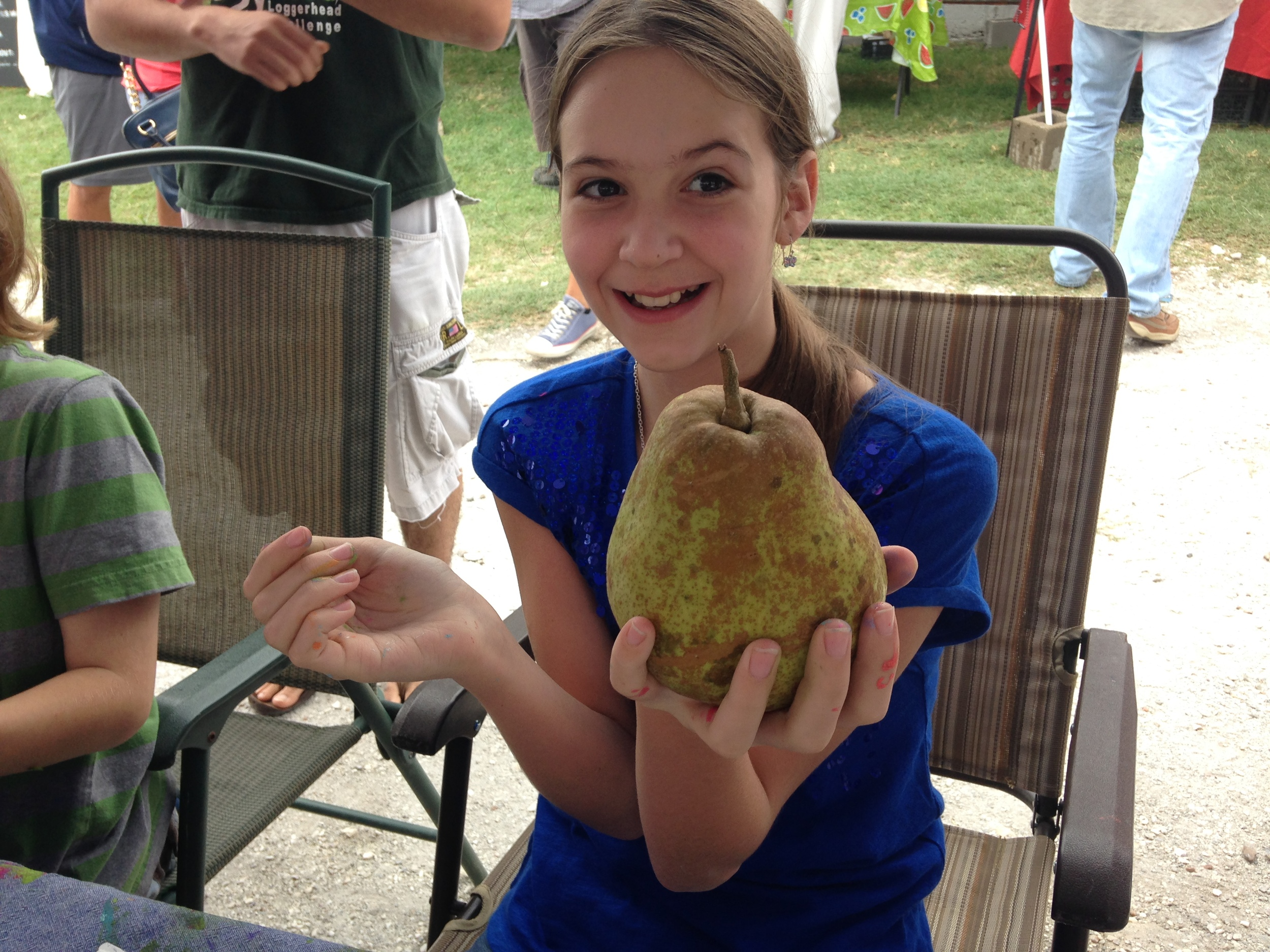 This little girl was amazed at the size of one of our Magness pears at Galveston's Own Famers' Market.