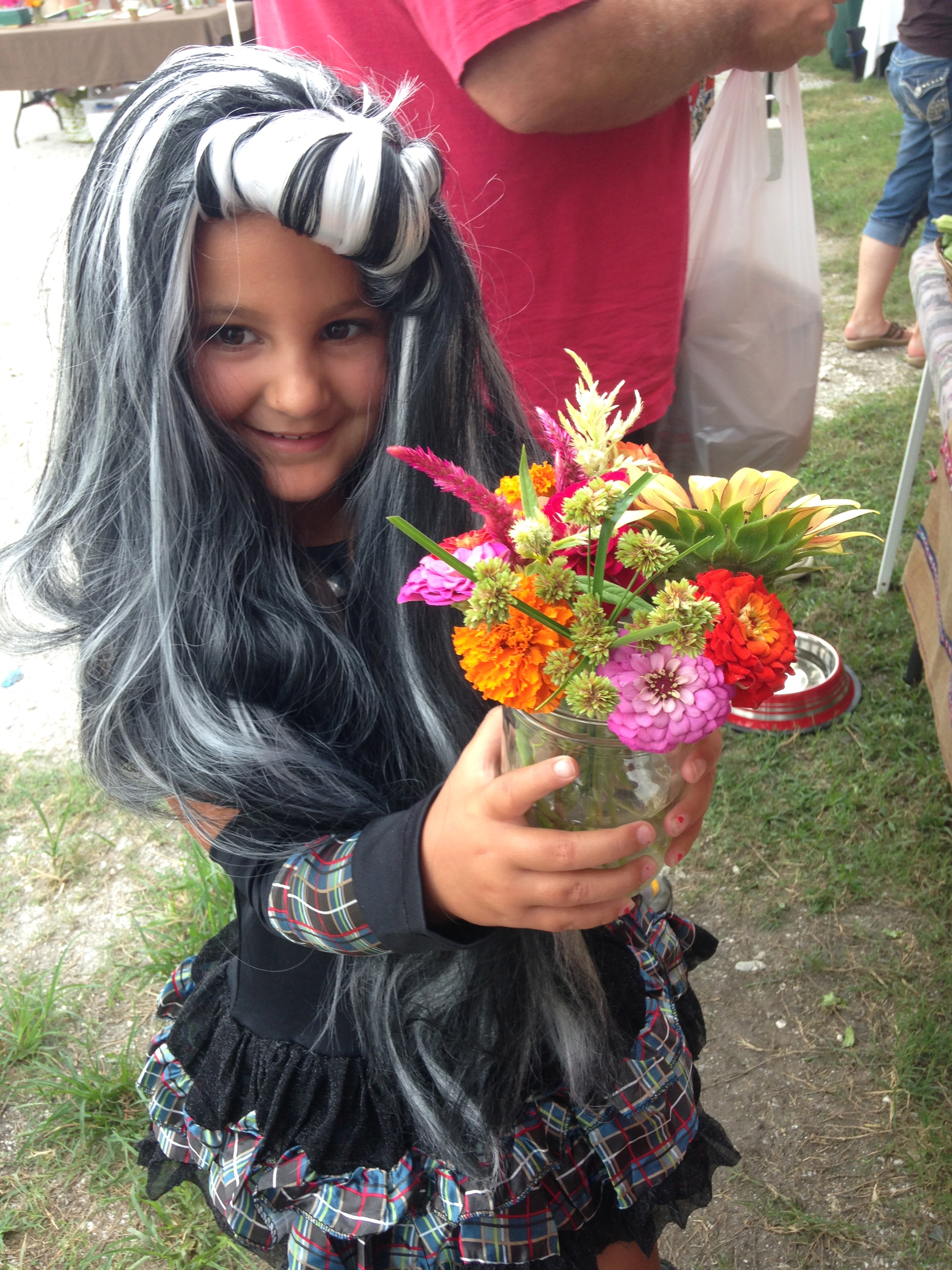 Our favorite customer of the day a few weeks ago, who just couldn't wait to don her Halloween costume, and loved our flower bouquets!