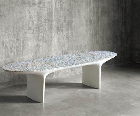 Fragments of plastic that washed up on beaches are being used to create eye-catching furniture, such as the Flotsam table.