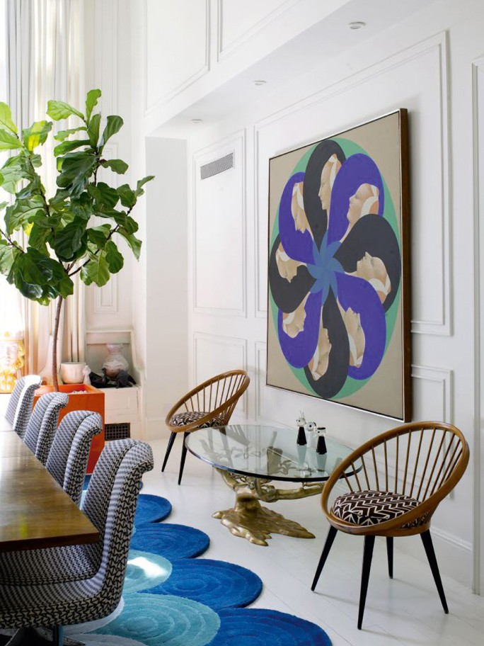 A 1970S PAINTING BY SANTE GRANZIANI AND TWO 1950S CHAIRS FROM SOUTH AMERICA DOMINATE THE OTHER SIDE OF THE SPACIOUS DINING ROOM IN NEW YORK. PHOTOGRAPH © RICHARD POWERS.