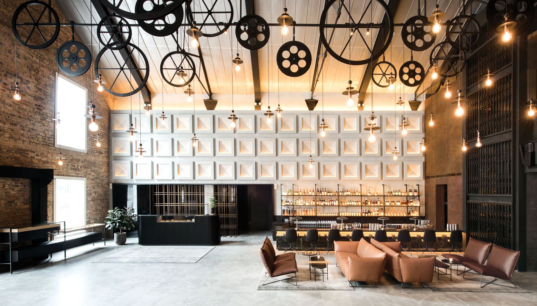 The Warehouse Hotel's lobby pays tribute to its spice-warehouse origins with pulleys artfully hung from the ceiling