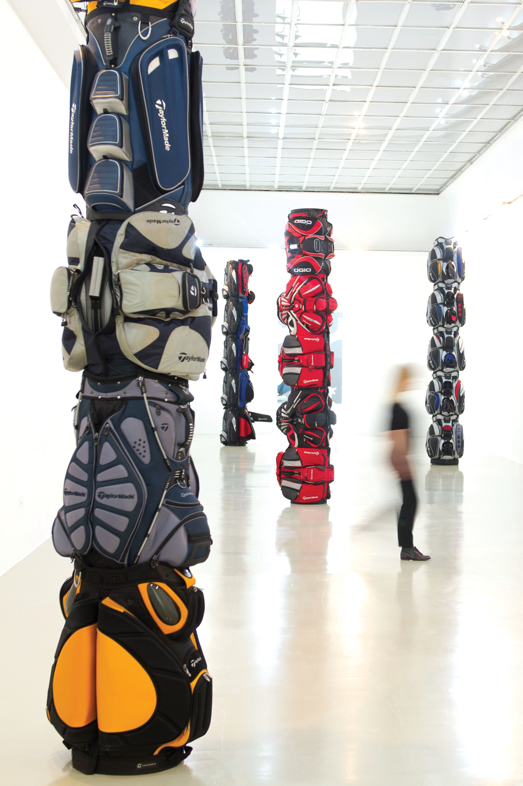 Totem poles by Canadian artist Brian Jungen, made from deconstructed golf bags