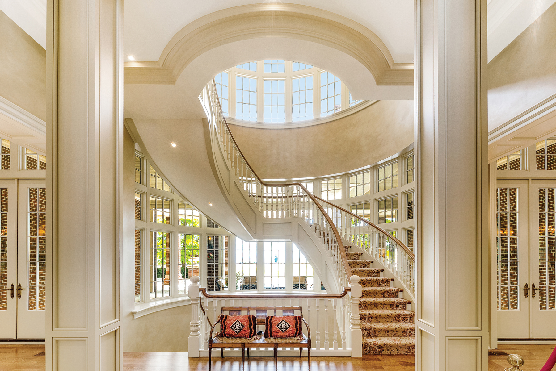 Expansive windows & magnificent domed glass ceilings allow natural light to stream into the foyer
