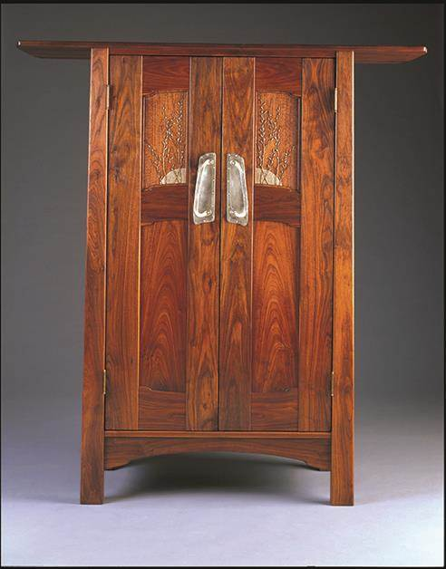- A Zito Schmitt Design cabinet with pussy-willow carvings