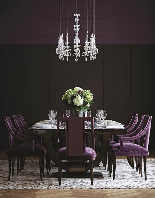 - Purple furniture pops in this black room by Taylor Howes.