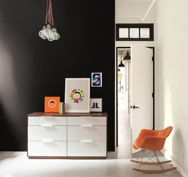 - A black accent wall in a bedroom