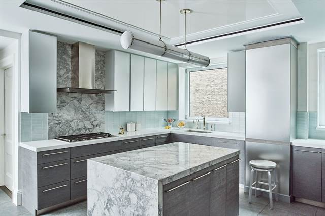A kitchen designed by Phillip Thomas shows off how marble works on more than just counter-tops.