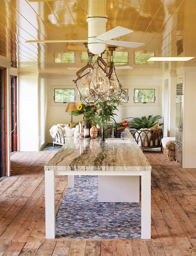 An interior designed by Phillip Thomas in Bellport, New York uses marble table as an accent