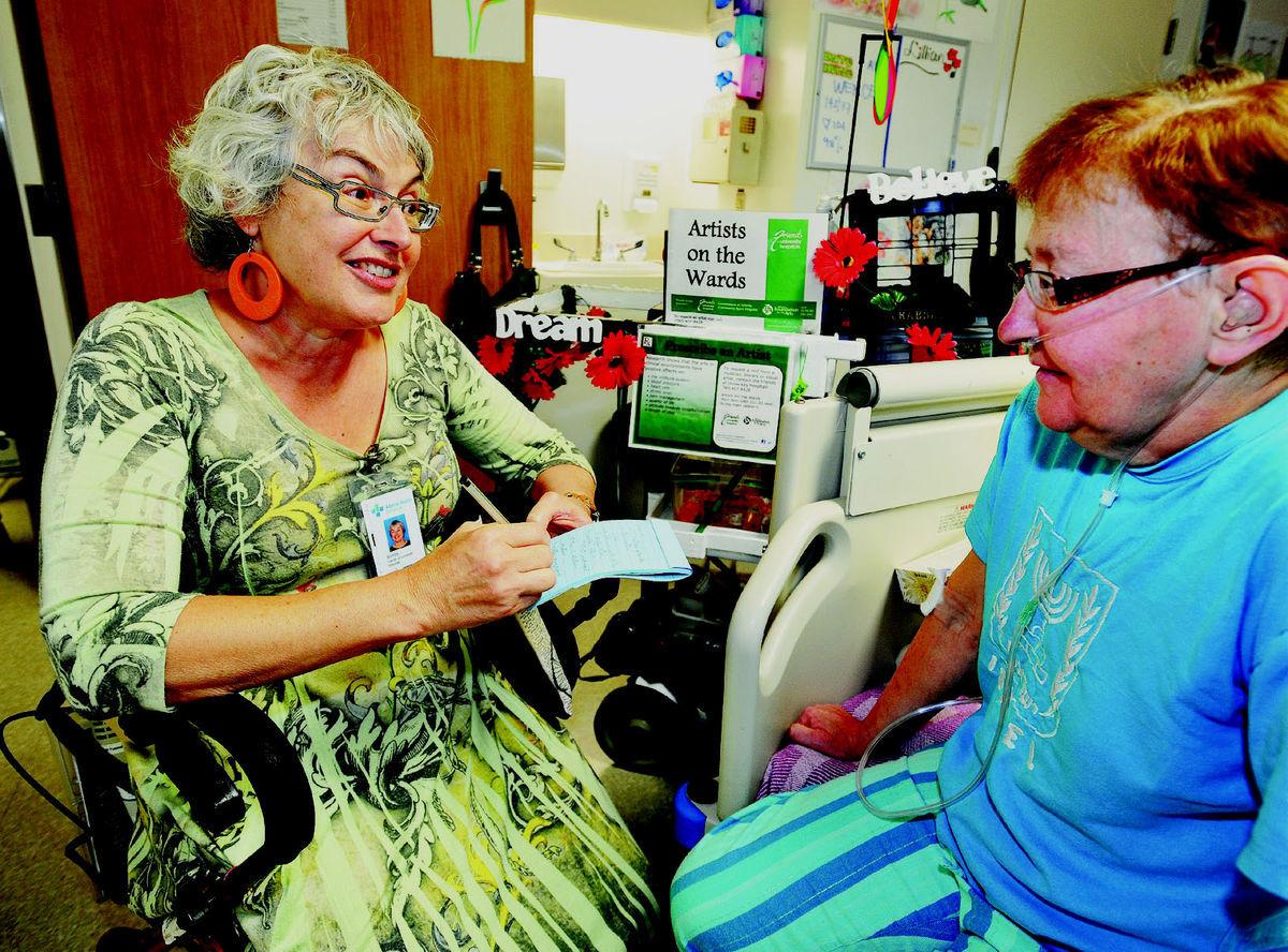 Poet Shirley Serviss visits University of Alberta Hospital patient Lillian Geddes as part of the hospital's Artists on the Wards program.    Photo Credit: Ed Kaiser/Edmonton Journal