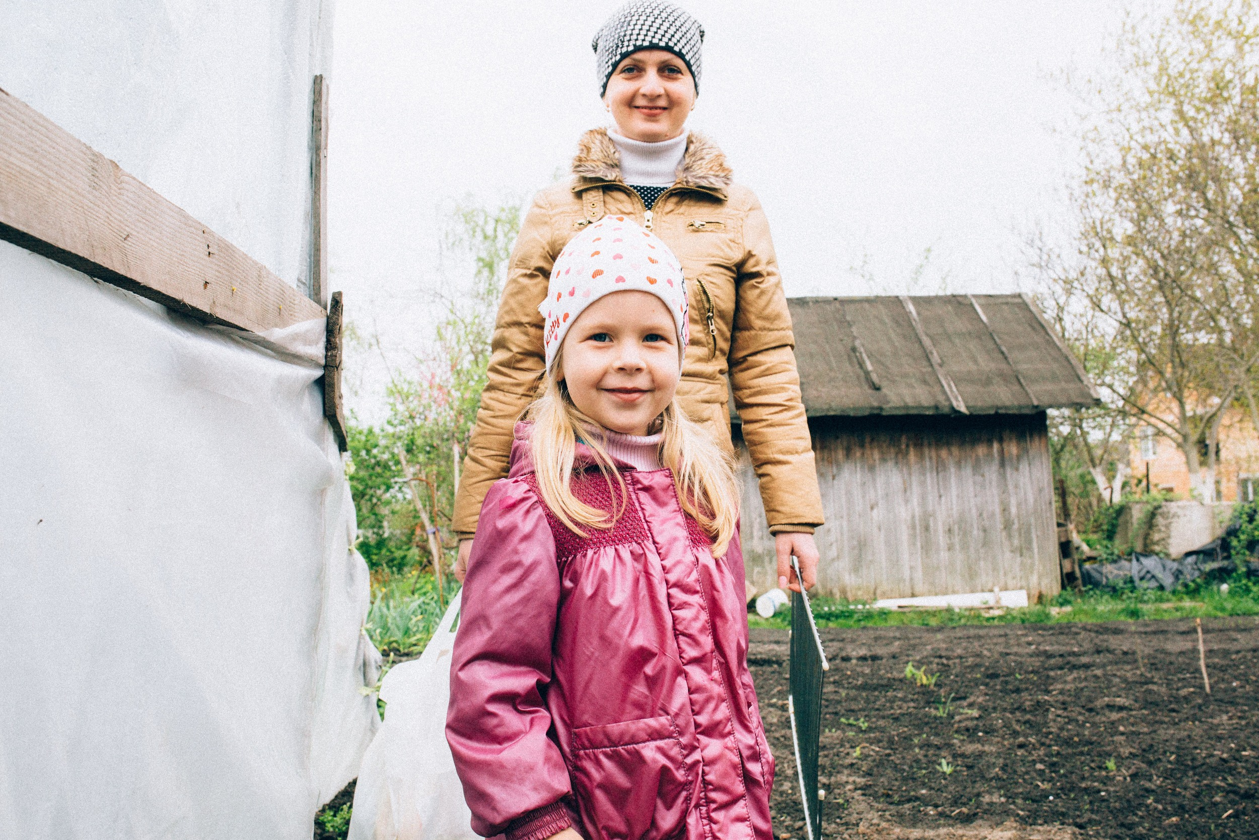We went to the dacha (country garden). Maria and Olena.