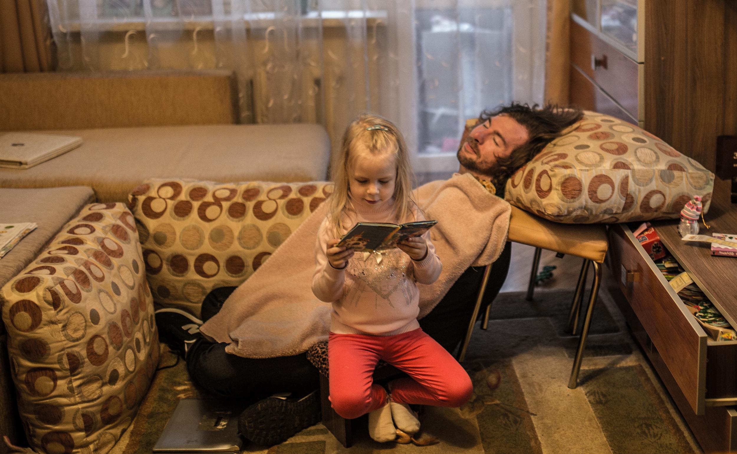 "Reading ""Dyadko Mykhylo"" a bedtime story."