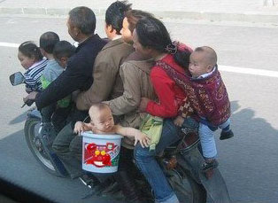 family_with_baby_on_motorcycle.jpg