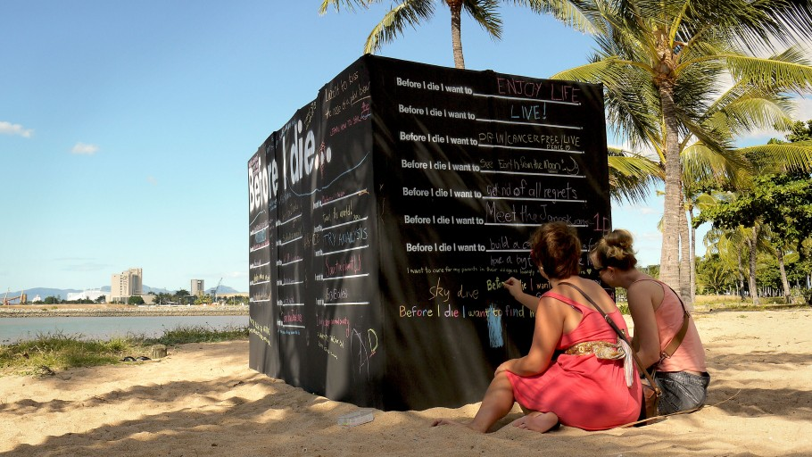 declaring dreams with toes in the sand in Townsville, Australia