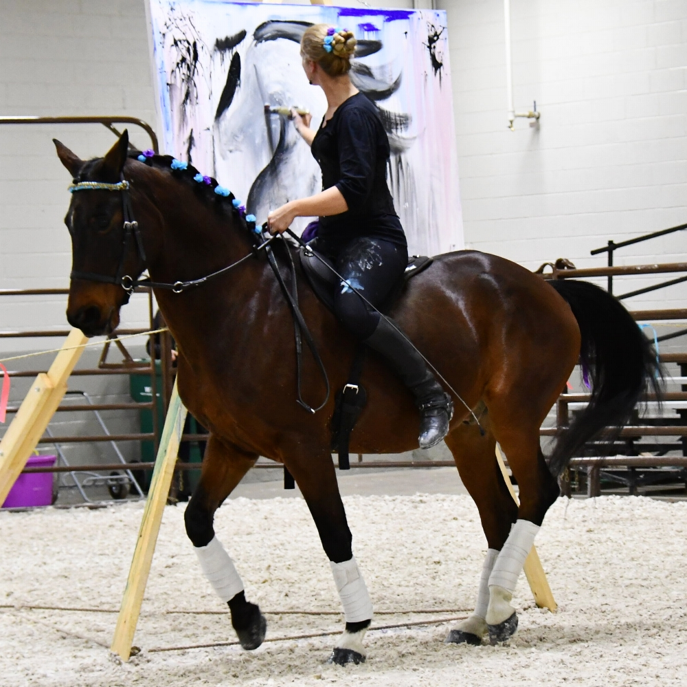 Rovandio performing piaffe during his live art demo at Equine Affaire 2017.