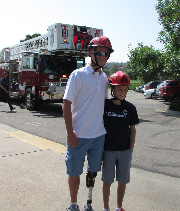 CMN Champions Garrison and Noah getting ready to go up in the fire truck to drop wine corks for the raffle.