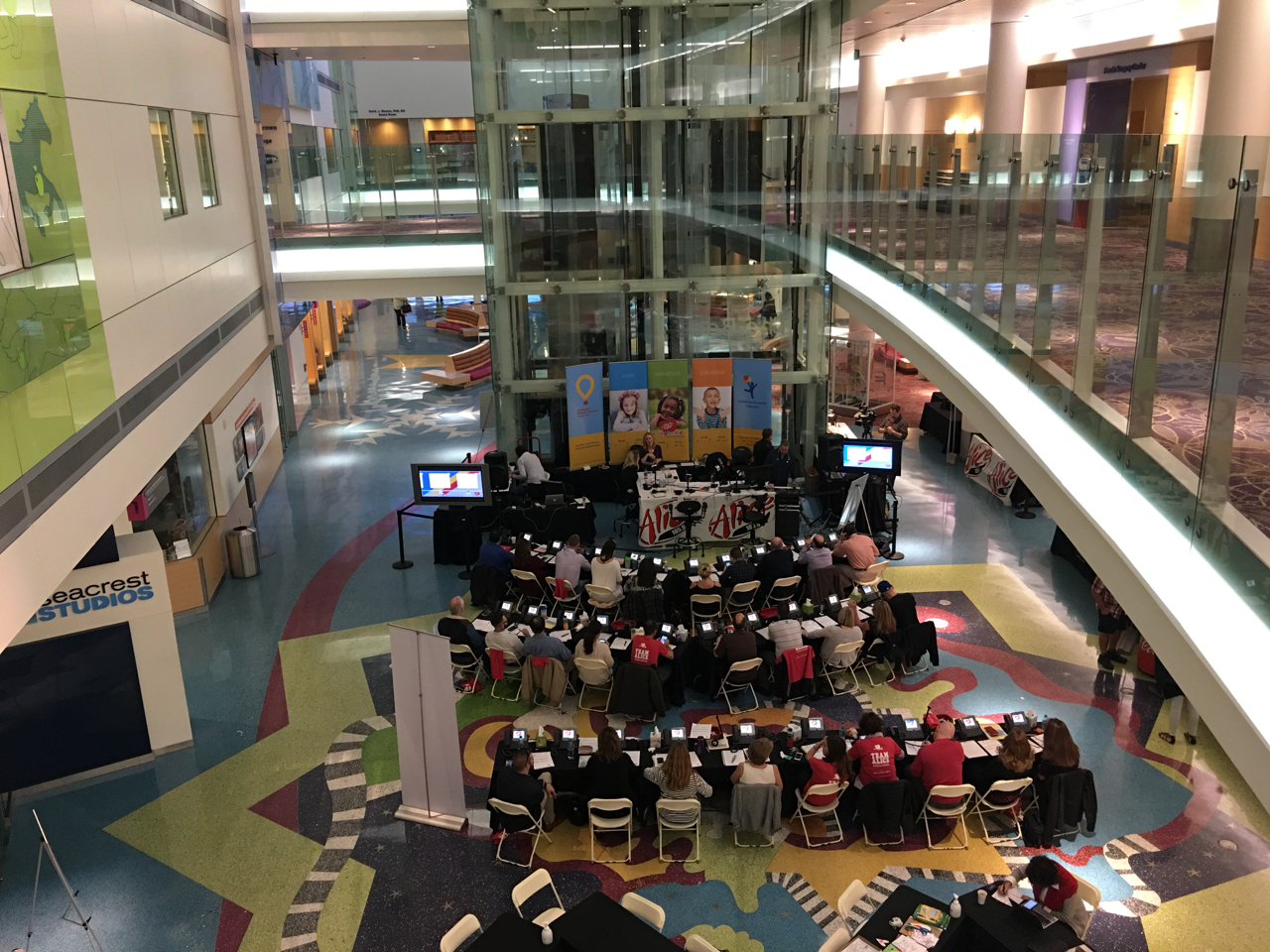 Volunteers from RE/MAX Alliance raise funds during a radiothon to benefit Children's Hospital