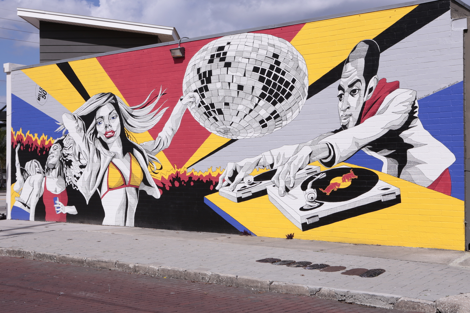 M-SQUARED X RED BULL MUSIC MURAL PAINTING BY ANDREW SPEAR. #WINGSTOWALLS LOCATED IN THE MILLS 50 DISTRICT IN ORLANDO, FL.